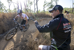 Jamie Whincup, Red Bull Holden on a mountain bike as Craig Lowndes takes a photo
