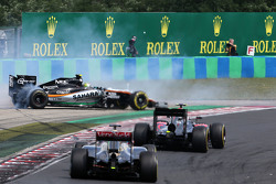 Sergio Perez, Sahara Force India and Pastor Maldonado, Lotus F1 Team