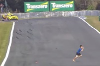 A kid crosses the track