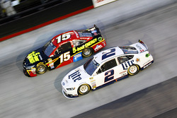 Clint Bowyer, Michael Waltrip Racing Toyota and Brad Keselowski, Team Penske Ford