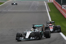 Lewis Hamilton, Mercedes AMG F1 W06 leads a lapped Jenson Button, McLaren MP4-30