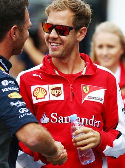 Sebastian Vettel, Ferrari with Christian Horner, Red Bull Racing Team Principal