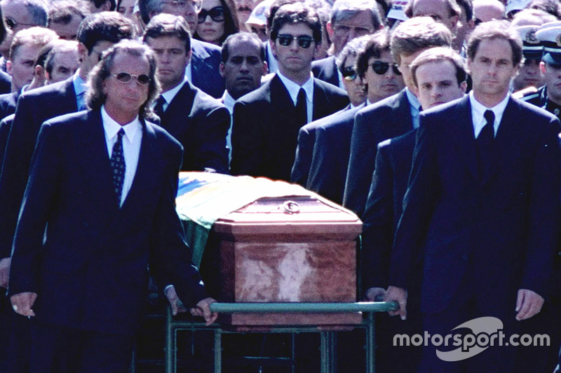 Emerson Fittipaldi, Jackie Stewart, Johnny Herbert, Derek Warwick, Gerhard Berger, Rubens Barrichello, Thierry Boutsen, Alain Prost and Damon Hill help lead the casket of Ayrton Senna during the funeral procession