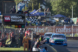 Mark Winterbottom and Steve Owen, Prodrive Racing Australia Ford crosses the finish line to win the race