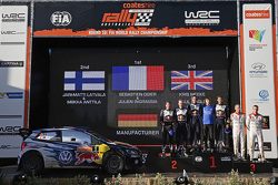 Podium: winners and 2015 WRC champions Sébastien Ogier and Julien Ingrassia, second place Jari-Matti Latvala and Miikka Anttila, third place Kris Meeke and Paul Nagle