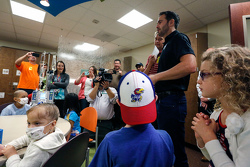 Jimmie Johnson, Hendrick Motorsports Chevrolet visits the pediatric ward at Kansas City's University of Kansas hospital