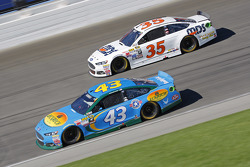 Aric Almirola, Richard Petty Motorsports Ford and Cole Whitt, Front Row Motorsports Ford