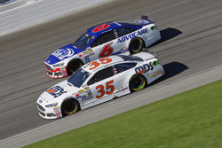 Cole Whitt, Front Row Motorsports Ford and Trevor Bayne, Roush Fenway Racing Ford