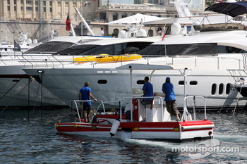 A water cleaning boat in the harbour of Monaco