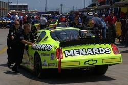 Paul Menard's car is pushed toward inspection