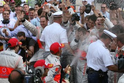 Team and photographers in the spray of the champagne from Fernando Alonso, McLaren Mercedes and Lewis Hamilton, McLaren Mercedes