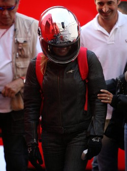 Michael Schumache and Corina Schumacher leave the track on a motor bike after the race