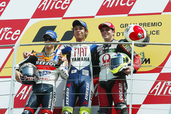 Podium: race winner Valentino Rossi, second place Dani Pedrosa, third place Alex Barros