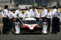 Team Peugeot Total team members push the car to the team photoshoot