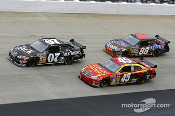 Clint Bowyer moves around the slower car of Kyle Petty