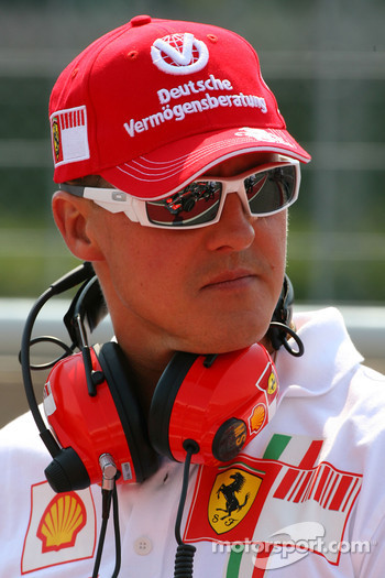 Michael Schumacher, Scuderia Ferrari, Advisor, with the reflection of Fernando Alonso, McLaren Mercedes in his sunglasses