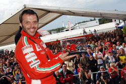 Loris Capirossi shows off a scale model of a Ducati