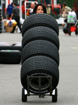Tanja Bauer, pushes tyres around the paddock