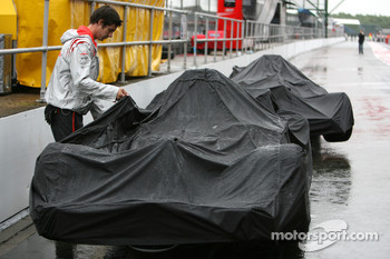 McLaren Mercedes Cars covered up in the pitlane