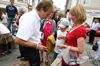 Frank Biela signs autographs at the traditional winners manhole cover ceremony in downtown Le Mans
