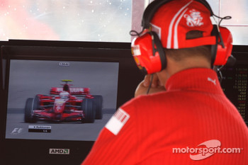 Michael Schumacher, Scuderia Ferrari, Advisor, watches Kimi Raikkonen, Scuderia Ferrari on the TV Monitors