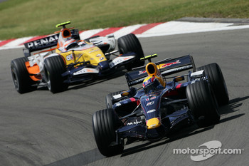 Mark Webber, Red Bull Racing, RB3 and Heikki Kovalainen, Renault F1 Team, R27