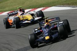 Mark Webber, Red Bull Racing, RB3 and Heikki Kovalainen, Renault F1 Team, R27
