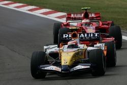 Heikki Kovalainen, Renault F1 Team, R27 and Kimi Raikkonen, Scuderia Ferrari, F2007