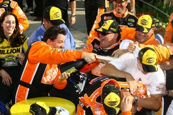 Victory lane: race winner Tony Stewart sprays champagne