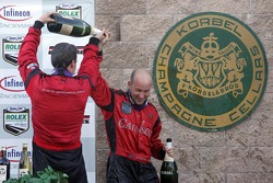 Podium: champagne for Alex Gurney and Jon Fogarty