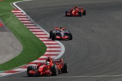 Felipe Massa, Scuderia Ferrari, F2007, Lewis Hamilton, McLaren Mercedes, MP4-22 and Kimi Raikkonen, Scuderia Ferrari, F2007