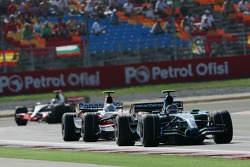 Rubens Barrichello, Honda Racing F1 Team, RA107 and Jarno Trulli, Toyota Racing, TF107