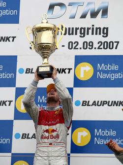 Podium: race winner Martin Tomczyk celebrates