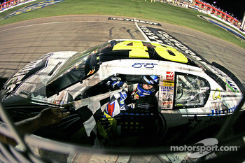 Race winner Jimmie Johnson is handed the checkered flag