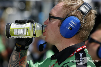 Rahal Letterman Racing team member drinks a well deserved refreshment