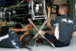 Red Bull Racing team members work on their car