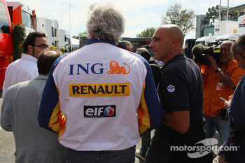 Flavio Briatore, Renault F1 Team, Team Chief, Managing Director is questioned by the media
