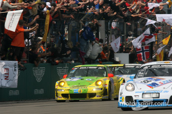 Race winner #1 Manthey Racing Porsche 911 GT3 RSR: Timo Bernhard, Marc Lieb, Romain Dumas, Marcel Tiemann celebrates