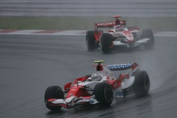 Jarno Trulli, Toyota Racing, TF107 leads Takuma Sato, Super Aguri F1, SA07