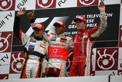 Podium: race winner Lewis Hamilton with Heikki Kovalainen and Kimi Raikkonen