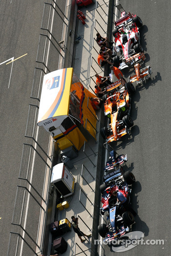 Cars queued for scrutineering in the paddock