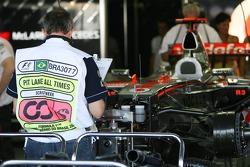 FIA Observer in the McLaren Mercedes garage