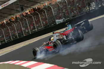 Lewis Hamilton, McLaren Mercedes, MP4-22 locks up a wheel into the first corner