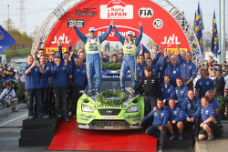 Podium: winners Mikko Hirvonen and Jarmo Lehtinen celebrates with BP Ford team members