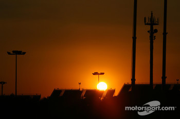 The sun sets over the grandstands