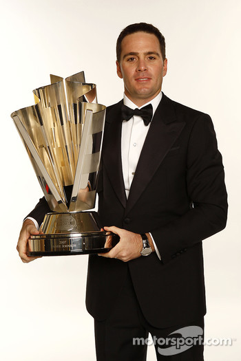 Jimmie Johnson poses with the championship trophy