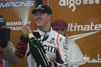Michael Schumacher sprays the champagne on the podium
