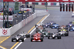 Start: Mika Hakkinen, McLaren and Michael Schumacher, Ferrari lead