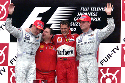 Podium: race winner and 2000 World Champion Michael Schumacher, Ferrari, second place Mika Hakkinen, McLaren, third place David Coulthard, McLaren, Jean Todt
