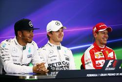 Polezitter Nico Rosberg, Mercedes AMG F1, derde plaats Sebastian Vettel, Ferrari en tweede plaats Lewis Hamilton, Mercedes AMG F1 Team